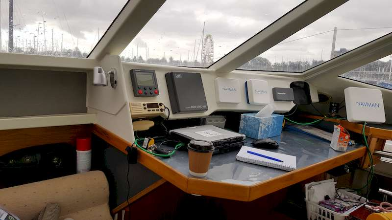The original navigation station was a narrow semi wrap around dash with room underneath to slide paper charts, no room here to install larger Chart Plotters and other navigation instruments, the challenge was to remove the old station and refit a larger staton able to accomodate the new equipment however still within the character of the boat.
